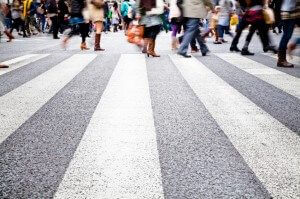 lots of people crossing a busy city crosswalk | Pedestrian Fatalities Continue to Rise in the US