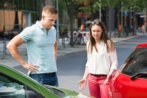 Man And Woman Talking After A Car Accident