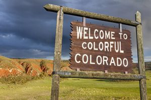 welcome to colorful Colorado sign in scenic country | Top Motorcycle Routes in Colorado
