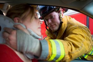 Fireman Putting Neckbrace On A Car Accident Victim