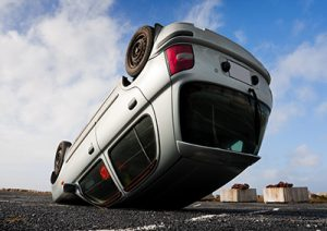 car turned upside-down after road collision | Surprising Car Accident Statistics