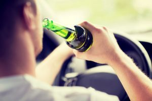 drunk-driver-holding-green-bottle-sm-300x200