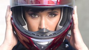 woman wearing red motorcycle helmet | Motorcycle Helmets Reduce the Risk of Spine Injuries