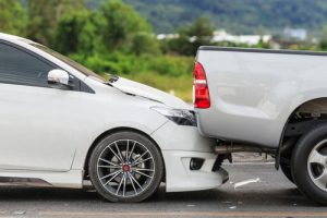 white car and grey truck in fender bender | Chain Reaction Accidents