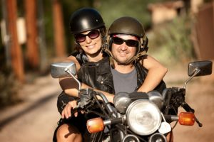 Happy-Man-and-Woman-on-Motorcycle-sm-300x200