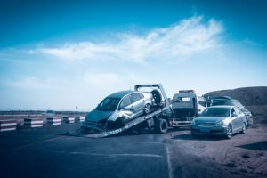 car-on-back-of-tow-truck-after-accident-sm-300x200