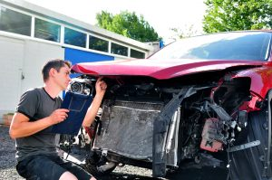 Insurance Adjuster Writing Down Damages For Insurance Claim