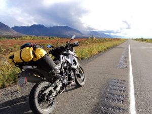 motorcycle-on-side-of-highway-with-yellow-pack-attached-sm-300x225