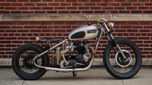 old-motorcycle-against-brick-wall-sm-300x169