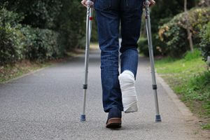 on-crutches-in-park-sm-300x200