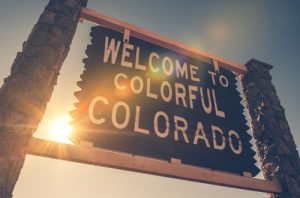 sun-shinning-from-behind-welcom-to-colorado-sign-sm-300x198