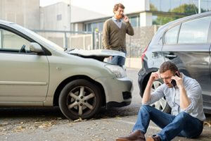 two-men-on-phone-after-rear-end-accident-sm-300x200