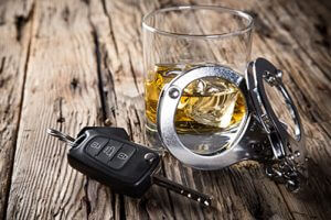 whiskey-keys-handcuffs-sm-300x200