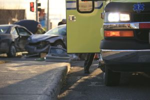 Ambulance Attending To Car Accident Victims