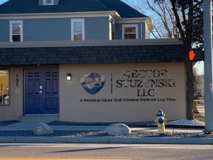 Front View Of Office Sign For Rector Stuzynski Llc
