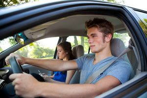 Teenagers Driving A Car Together