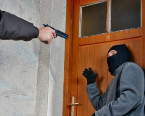 person about to shoot an intruder without penalty because of the make my day law in colorado