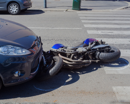 motorcycle under a car because the driver didnt see the motorcycle rider